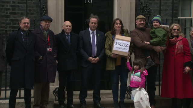exterior shots 6 year old alfie dingley arriving at 10 downing street with his parents and celebrities including sir patrick stewart and pose for the... - legalisation stock videos & royalty-free footage