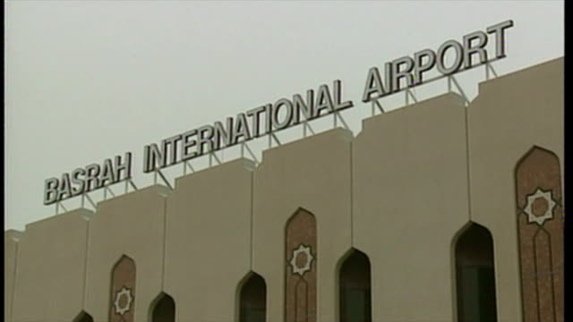 exterior shots abandoned basrah international airport at the start of the 2003 invasion of iraq police motorbike and luggage trolley left outside on... - bassora video stock e b–roll