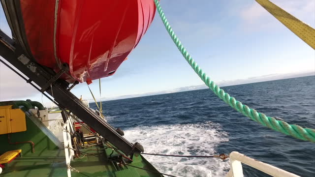 exterior shots aboard the greenpeace arctic sunrise as she sails through the barants sea with sacks of recovered fishing nets on the deck on july 12... - svalbard and jan mayen stock videos & royalty-free footage