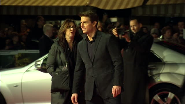 exterior shots actor tom cruise stands and poses for photographers on red carpet at premiere of 'jack reacher' film. new 'jack reacher' film premiere... - roter teppich stock-videos und b-roll-filmmaterial