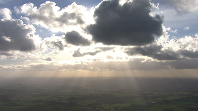 exterior shots aerials dark rain clouds in sky sun rays shining through clouds crepuscular rays on february 22 2014 in various cities united kingdom - cloud sky stock videos & royalty-free footage
