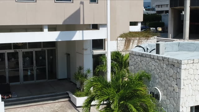 exterior shots aerials drone jamaica headquarters international seabed authority and jamaica conference centre and sign reading out of many one... - seabed stock videos & royalty-free footage