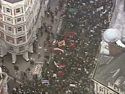 exterior shots aerials protesters completely fill shaftesbury avenue down to piccadilly circus aerials anti war protesters in central london on... - peace demonstration stock videos & royalty-free footage