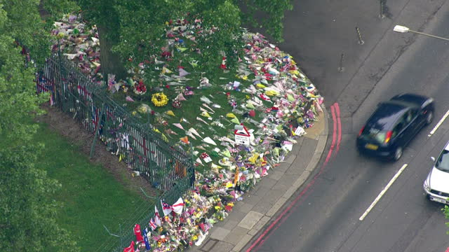 exterior shots aerials woolwich tributes flowers at side of road by woolwich murder scene aerials woolwich murder scene tributes at roadside on may... - roadside stock videos & royalty-free footage