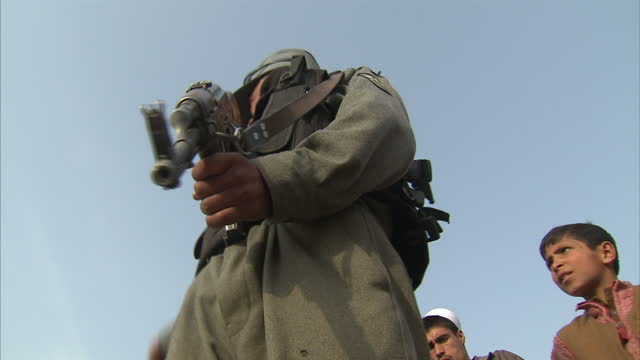 exterior shots afghan soldier holding gun on march 16 2012 in kabul afghanistan - army stock videos & royalty-free footage