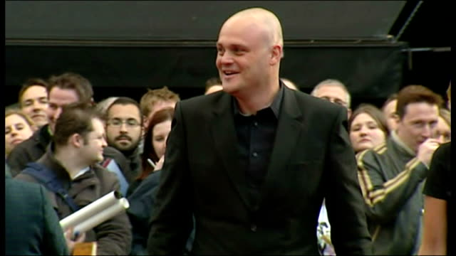 exterior shots al murray 'the pub landlord', comedian, with his wife amber hargreaves on the red carpet for the premiere of iron man at the odeon... - al murray stock videos & royalty-free footage