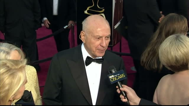 Exterior shots Alan Arkin chats to reports on the red carpet Alan Arkin on the Red Carpet at Dolby Theatre on February 25 2013 in Hollywood California
