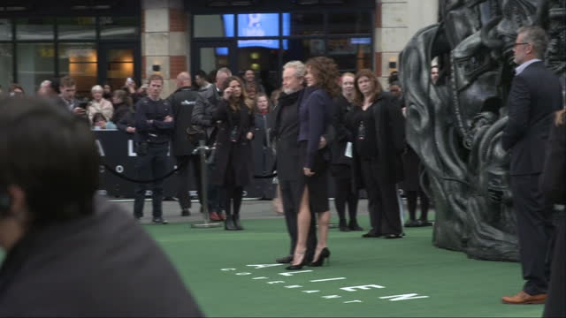 exterior shots alien: covenant film premiere in leicester square, sir ridley scott, director and giannina facio posing for snappers on red carpet in... - リドリー・スコット点の映像素材/bロール