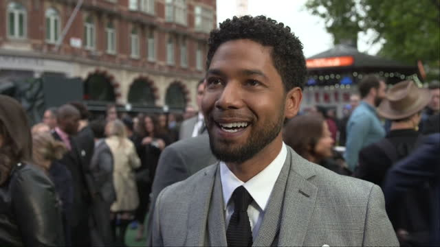 Exterior shots Alien Covenant film premiere in Leicester Square Jussie Smollett actor talking to press on red carpet in London England on Thursday...
