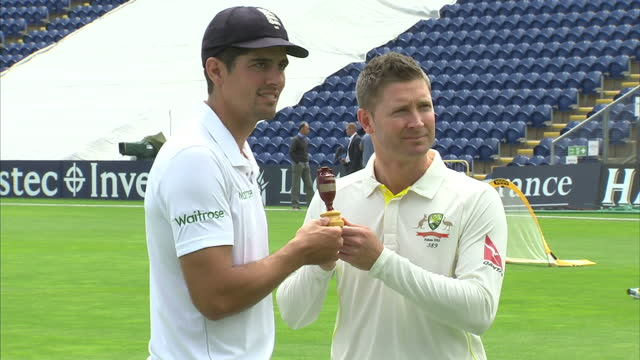 exterior shots alistair cook england cricket captain and michael clarke australian cricket captain posing on pitch at swalec stadium with the ashes... - cenere video stock e b–roll