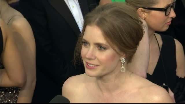 Exterior shots Amy Adams chats to reporters on the red carpet Amy Adams Chats to Reporters on the Red Carpet at Dolby Theatre on February 25 2013 in...