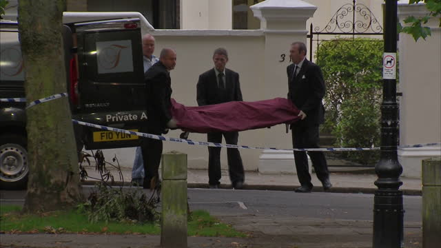 Exterior shots Amy Winehouse body removed from house and taken away in a private ambulance Sky News archival Winehouse clips on July 23 2011 in...