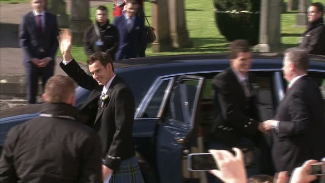 exterior shots andy murray arrives for his wedding along with brother jamie, gets out of car to cheering from onlookers on april 11, 2015 in... - dunblane stock videos & royalty-free footage