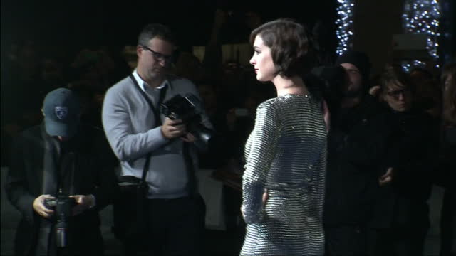 Exterior shots Anne Hathaway posing for cameras on red carpet