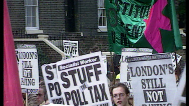 exterior shots antipoll tax protesters marching down road carrying banners claiming 'class war' on october 20 1990 in brixton london england - assertiveness stock videos & royalty-free footage