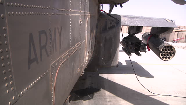 exterior shots apache helicopters on runway at camp bastion british apache helicopters at camp bastion at camp bastion on august 19 2013 in lashkar... - アパッチヘリコプター点の映像素材/bロール