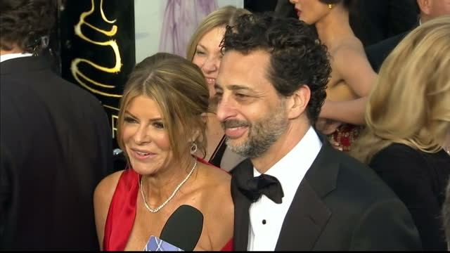 Exterior shots Argo producer Grant Heslov his wife chat to the press on the red carpet Grant Heslov his Wife on the Red Carpet at Dolby Theatre on...