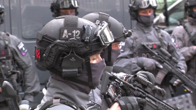 Exterior shots armed Metropolitan Police CounterTerrorism officers standing in line wearing balaclavas and protective equipment at launch of...