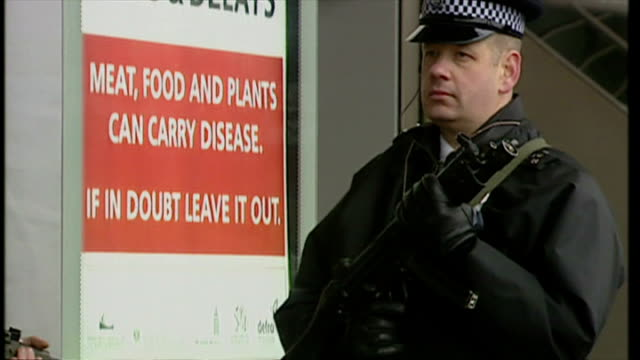 exterior shots armed police officers standing talking with armed soldiers in military combat uniform outside heathrow terminal building as part of... - military uniform stock videos & royalty-free footage