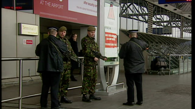 exterior shots armed soldiers in military combat uniform standing outside heathrow terminal building as part of increased security at british... - military uniform stock videos & royalty-free footage