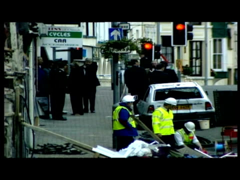 exterior shots army vehicles at scene and clean up teams spk at scene of bombing exterior long high shots mo mowlam mp walk down main road past... - bombing stock videos & royalty-free footage
