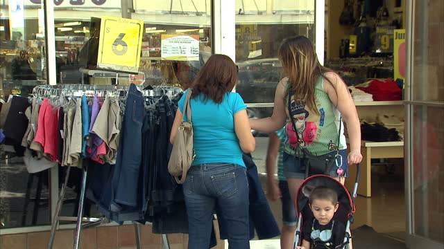 exterior shots around the main street of mcallen in the rio grande valley close to the border with mexico, with hispanic shoppers buying clothing,... - mcallen texas stock videos & royalty-free footage