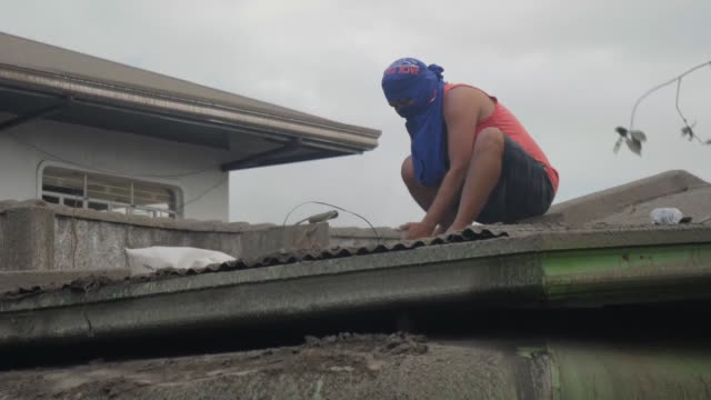 exterior shots ash covered roads with damaged houses after the taal volcano eruption on 15 january 2020 in laurel in batangas province philippines - taal volcano stock videos & royalty-free footage