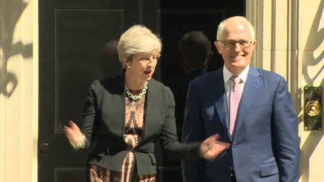 Exterior shots Australian Prime Minister Malcom Turnbull arriving at 10 Downing Street greeted by British Prime Minister Theresa May who poses for...