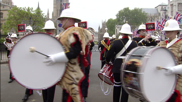 exterior shots band of the royal marines marches in formation along whitehall. exterior high shots parliament square with the royal marine band... - royal marines stock videos & royalty-free footage