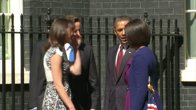 exterior shots barack michelle obama arrive at number 10 downing street walk over to greet david cameron his wife samantha exterior shots the... - photo call stock videos & royalty-free footage