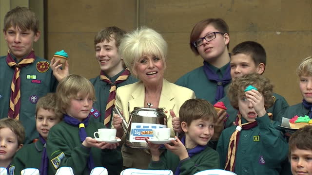 exterior shots barbara windsor and cubs & boy scouts pose for photo op at street party style lunch at buckingham palace. event to promote queen's... - boy scout stock videos & royalty-free footage