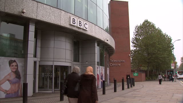 exterior shots bbc television centre building highlighting entrance area buildings large bbc logos bbc television centre exteriors on october 23 2012... - symbol stock videos & royalty-free footage