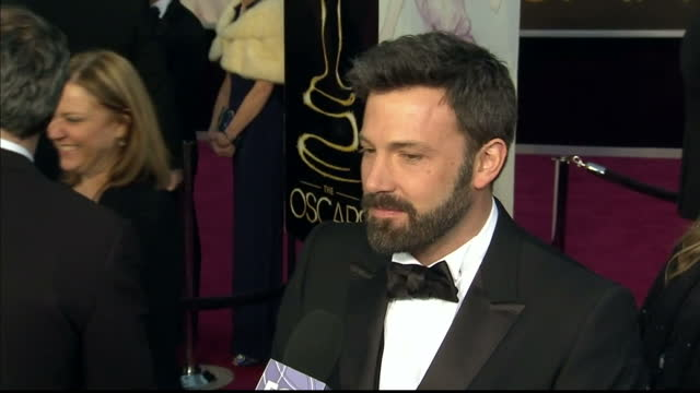 Exterior shots Ben Affleck chats to reporters on the red carpet Ben Affleck on the Red Carpet at Dolby Theatre on February 25 2013 in Hollywood...