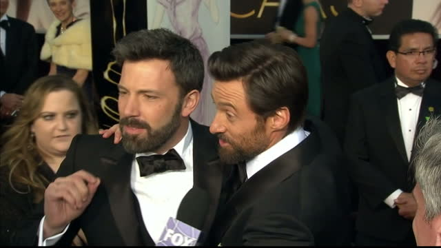 Exterior shots Ben Affleck Hugh Jackman share a joke with reporters on the red carpet Ben Affleck Hugh Jackman on the Red Carpet at Dolby Theatre on...