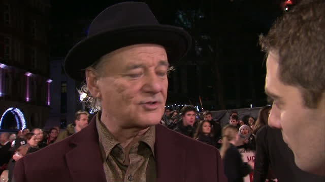 Exterior shots Bill Murray actor in 'The Monuments Men' talking at UK premiere about working with director George Clooney on in London England