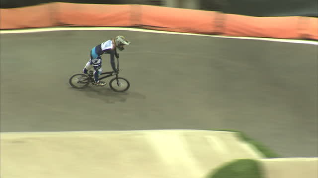 exterior shots bmx riders riding over bumpy bmx course in manchester bmx riders perform on bmx course on august 02 2012 in manchester england - bumpy stock videos & royalty-free footage