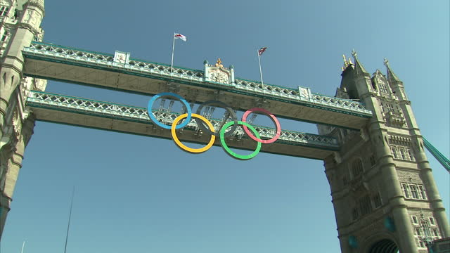 exterior shots boat on the thames passes under tower bridge with the olympic rings logo suspended from the span sky news olympics opening day... - olympic rings stock videos & royalty-free footage