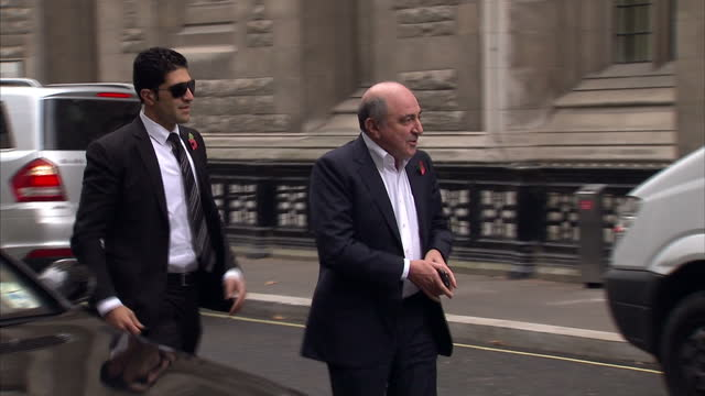 exterior shots boris berezovsky gets out of car walks to the high court boris berezovsky arrives at the high court on october 31 2011 in london... - 実業家 ボリス・ベレゾフスキー点の映像素材/bロール