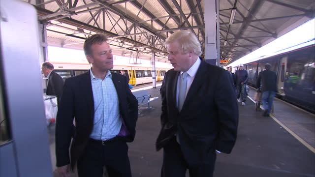 vídeos de stock e filmes b-roll de exterior shots boris johnson mayor of london arriving by train at ramsgate and being welcomed by conservative candidate craig mackinlay on april 21... - ramsgate