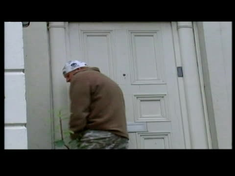 exterior shots boris johnson returns home from jogging wearing bandanna on head & comments to press before entering home / exterior shots boris... - boris johnson stock videos & royalty-free footage