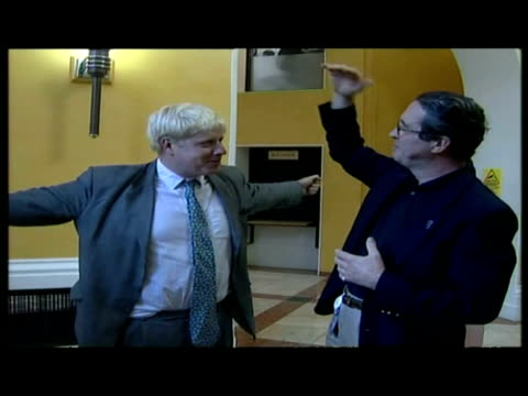 exterior shots boris johnson walks into building interior shots boris johnson talks to press comments on his apology for causing offence to liverpool - reconciliation stock videos & royalty-free footage