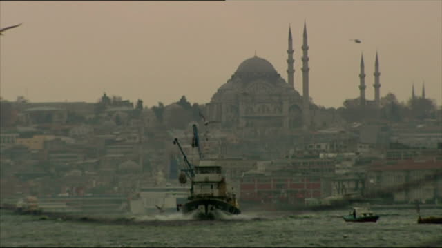 exterior shots bosphorus shore fishing boats view of suleymaniye mosque fishermen near ortakoy mosque on november 09 2006 in istanbul turkey - suleymaniye mosque stock videos and b-roll footage