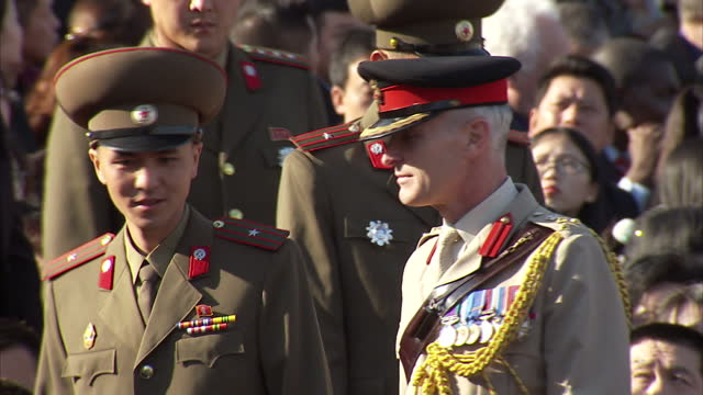 exterior shots brigadier simon levey british defence attache to beijing is shown to his seat by north korean military officer to watch workers party... - military parade stock videos and b-roll footage