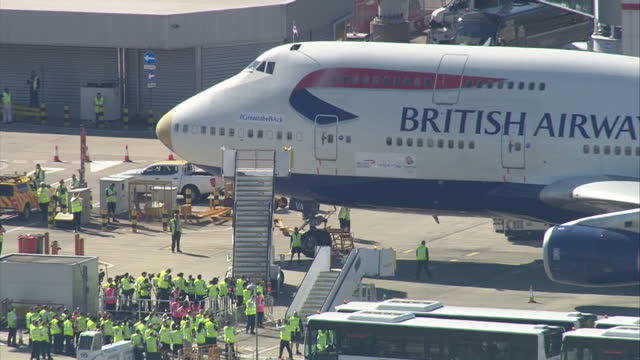exterior shots british airways flight ba2016 with gold nose parked on apron at heathrow airport after bringing team gb athletes back from the rio... - homecoming stock videos & royalty-free footage