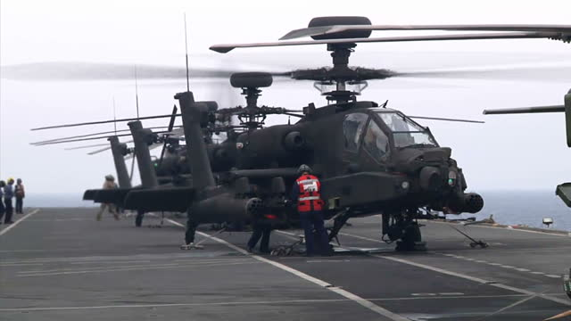 exterior shots british army air corps agustawestland apache ah1 attack helicopters taking off from flight deck of hms ocean on june 04 2011 at sea - british military stock videos & royalty-free footage