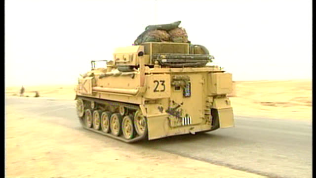 exterior shots british military apc driving along road at the start of the 2003 invasion of iraq on march 26 2003 in southern iraq - british military stock videos and b-roll footage