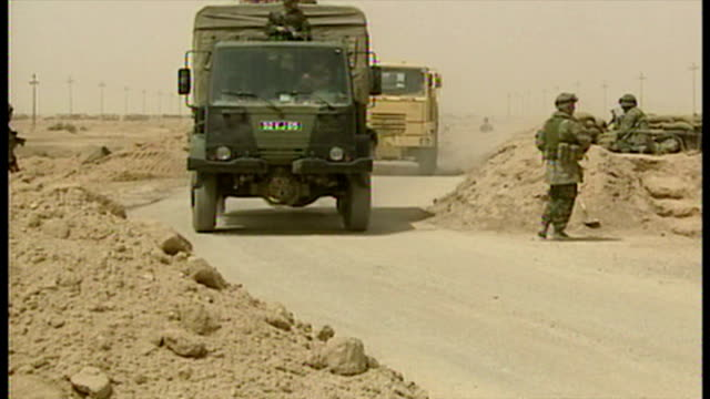 exterior shots british military convoy moves along road with british soldiers on lookout at side of road at the start of the 2003 invasion of iraq on... - british military stock videos & royalty-free footage