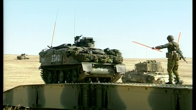 exterior shots british soldier guiding british military alvis spartan apc over bridge built by british army engineers at the start of the 2003... - bassora video stock e b–roll