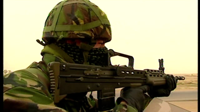 exterior shots british soldier on lookout from top of british military land rover as it moves along road at the start of the 2003 invasion of iraq on... - british military stock videos and b-roll footage