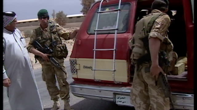 exterior shots british soldiers at road checkpoint in umm qasar stopping and searching vehicles driven by iraqi civilians at the start of the 2003... - civilian stock videos & royalty-free footage